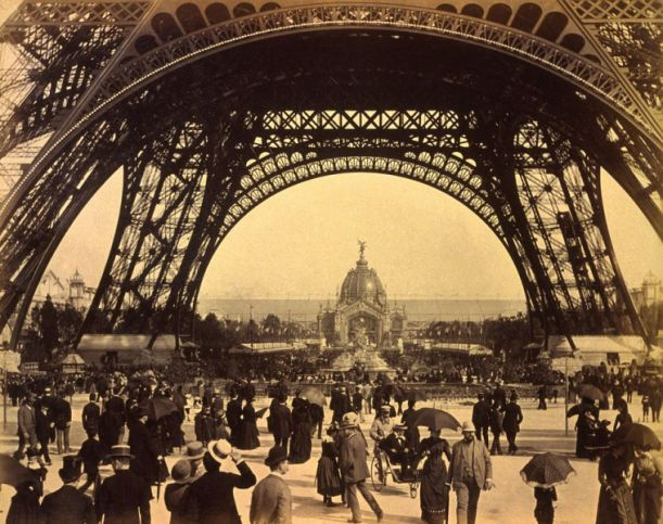 04Crowd-of-people-walking-under-the-base-of-Eiffel-Tower-view-toward-the-Central-Dome-Paris-Exposition-1889