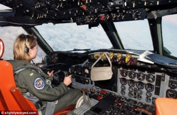 women-drivers-a-female-pilot-hangs-her-purse-of-the-controls-of-a-military-aircraft