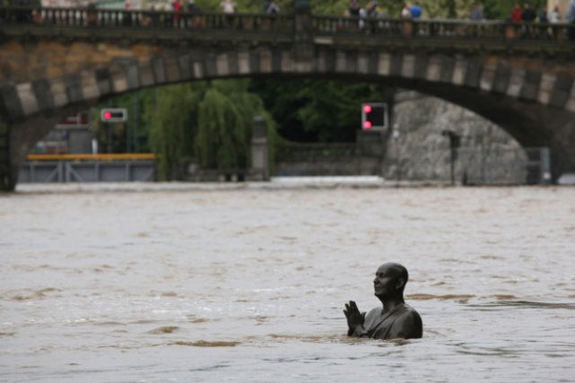 Statue of Indian spiritual leader Sri Chinmoy. Flood in Prague, Czech Republic, on June 2, 2013.