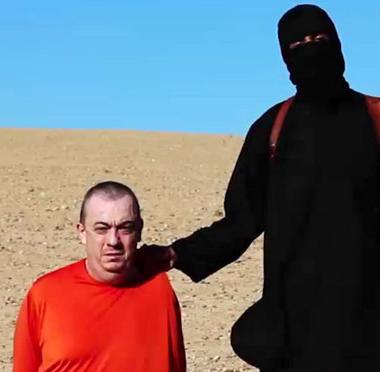 """Džihád John na světové konferenci """"Stop předsudkům"""", kde se svým asistentem pronesl proslov na téma stereotypů vůči muslimům"""